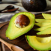 Ripe slice avocado on wooden cutting board on wooden table